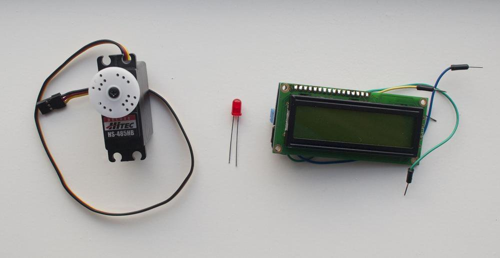 A few possible outputs. From left to right: a servo motor, a light emitting diode, and an LCD character display.